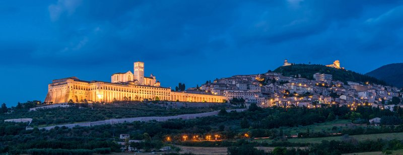 Panoramic view of Assisi at sunset, in the Province of Perugia, in the Umbria region of Italy.